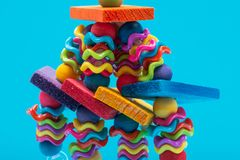 Wiggles and Wafers Bird Toy for all kind of birds, Parrots. Prevents Bird Boredom. Wiggles and Wafers Bird Toy for all kind of birds, including Parrots royalty free stock photo