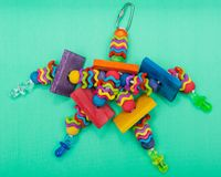 Wiggles and Wafers Bird Toy for all kind of birds, Parrots. Prevents Bird Boredom. Wiggles and Wafers Bird Toy for all kind of birds, including Parrots stock image