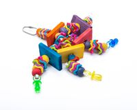 Wiggles and Wafers Bird Toy for all kind of birds, Parrots. Prevents Bird Boredom. Wiggles and Wafers Bird Toy for all kind of birds, including Parrots stock photo