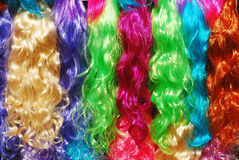 Wigs. Colorful wigs at the market Royalty Free Stock Image