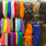 Wigs in different colours on display Royalty Free Stock Photography