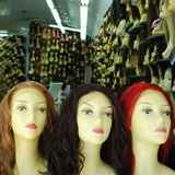 Wigs. Interior  of a wigs shop Royalty Free Stock Photos