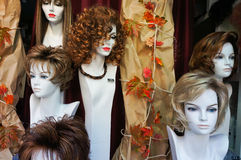Wigs on manikin heads. Female wigs or toupees on manikin heads Royalty Free Stock Images