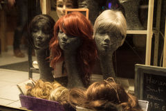 Wigs on the shop window, Ostend, BelgiuFence around playground, Ostend, Belgium Royalty Free Stock Image