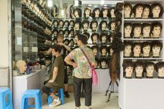 Wigs shop in old part of Shanghai, China Royalty Free Stock Image