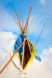 Wigwam. Top of a traditional wigwam against a bright blue summer sky royalty free stock images