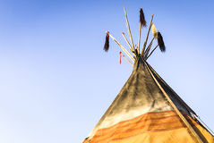 Wigwam. Indian tent in front of blue sky Royalty Free Stock Image