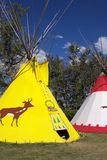 Wigwam. Bright colors form wigwams with blue sky stock photography