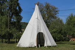 Wigwam in American style pitched in the field.  stock images
