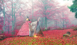 Wigwam in the autumn forest royalty free stock image