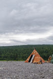 Wigwam of birch bark on the island. Bahta river. Stock Images