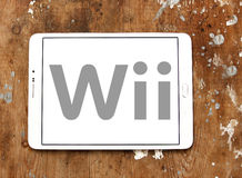 Wii logo. Logo of wii games company on samsung tablet on wooden background Royalty Free Stock Photo