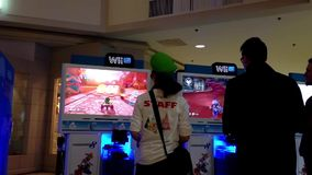 Wii store stuff demonstrates car racing game. Inside Coquitlam center shopping mall stock video footage