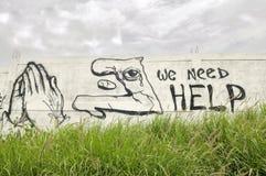 Wij hebben Hulp nodig. Stock Foto's