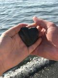 Wij vonden liefdesteen op het strand Stock Foto's