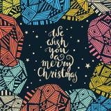 Wij wensen u vrolijke Kerstmis - citeer op gevormde achtergrond Stock Foto