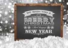 Wij wensen u Vrolijke Kerstmis en een Gelukkig Nieuwjaar op bord Royalty-vrije Stock Foto's