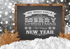 Wij wensen u Vrolijke Kerstmis en een Gelukkig Nieuwjaar op bord w Royalty-vrije Stock Foto