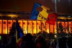 ` Wij zien u `-bericht van protesteerders in Boekarest, Roemenië Stock Foto