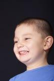 Wijd glimlachende jongen Stock Foto