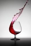 Wijn bespat in Glas Royalty-vrije Stock Afbeelding