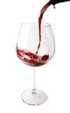 Wijn die in Groot Glas wordt gegoten Royalty-vrije Stock Fotografie