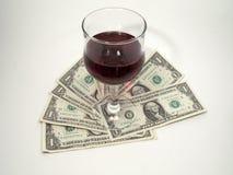 Wijn en geld Stock Foto's