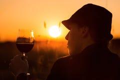 Wijn en zonsondergang Stock Afbeelding
