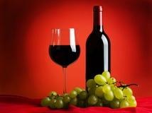 Wijn, glas, en druiven Stock Foto