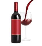 Wijn het gieten in wijnglas met fles Stock Foto