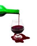 Wijn in het glas, de gemorste wijn stock afbeeldingen