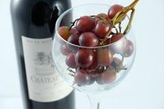 Wijnglas, druiven en fles Royalty-vrije Stock Afbeeldingen