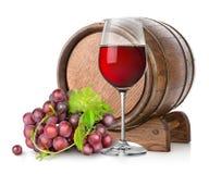 Wijnglas met druif en vat stock afbeelding