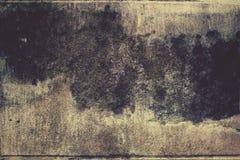 Wijnoogst van de vlek de donkere kleur op de oude muur Stock Afbeelding