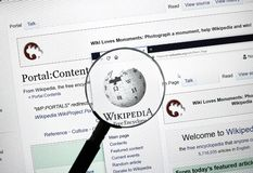 Wikipedia Home Page Under Magnifying Glass  Editorial Image