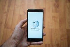 Wikipedia logo on smartphone screen Stock Photos