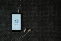 Wikipedia logo on smartphone screen Royalty Free Stock Image