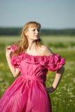 Wiktoriańska dziewczyna w rocznik menchii sukni Fotografia Stock
