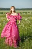 Wiktoriańska dziewczyna w rocznik menchii sukni Obrazy Stock