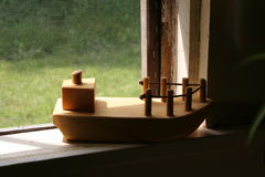 Wil's Boat in the Window. Wil's Wooden Boat in the Window-sill Stock Images