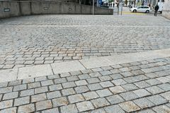 Wil, SG / Switzerland - April 8, 2019: cobblestone road leading from the old town of Will down into the new city with traffic and