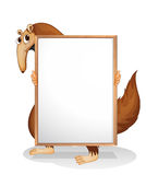 A wild animal holding an empty whiteboard Royalty Free Stock Photos