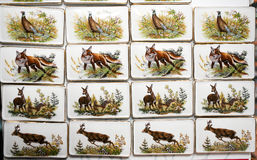 Wild animal motifs on handmade porcelain fridge magnets Stock Photos