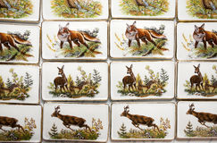 Wild animal motifs on handmade porcelain fridge magnets stock images
