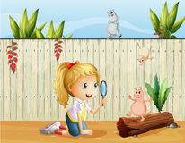 Wild animals and a girl with a magnifying glass Royalty Free Stock Photos