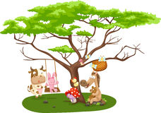 Wild animals near the big tree Royalty Free Stock Photo