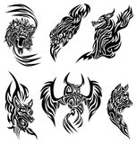 Wild animals tattoo. Some tattoo 's designs with wild animals and birds: an owl, an eagle, a wolf, foxes, a lion Royalty Free Stock Images