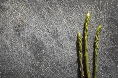 Wild asparagus on a dark cutting desk and space for text stock image
