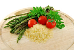Wild asparagus with ingredients Royalty Free Stock Image