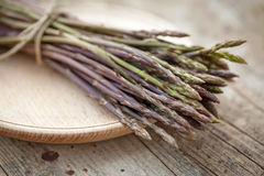 Wild asparagus spears in bunch Stock Photo